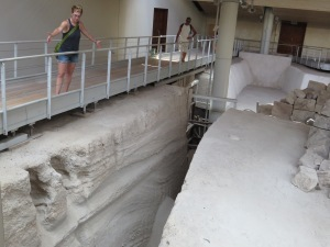 The wavelength of Phase 2 pyroclastic surges featured in the center on the left wall in the crevasse. Note Professor Skinner for scale, she is holding her arms roughly a meter apart.