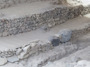 Two blocks embedded in a Minoan wall from the increased excavation of Phase 2. They are roughly .75 and 1 meter wide.