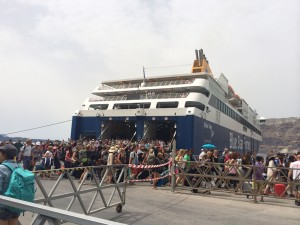 The flock of tourists exiting the ferry, beginning their own journeys on Santorini