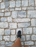 Starting this journey off in 5th century BC: This marble path leads right to the Acropolis which was also known as the road to democracy. (Figure 1)