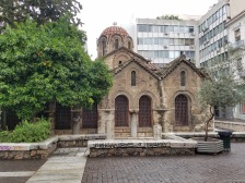 Now traveling forward about 600 years to 11th century BC.: This is the Church of Panagia Kapnikarea which is a Greek Orthodox Church. Built in 11th century BC it is one of the oldest churches in Athens. This church is dedicated to Panagia which is the Virgin Mary. Notice how this church is intertwined between the newer and taller buildings around it. Not exactly something you would see back in the U.S. (Figure 4)