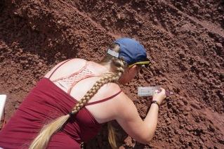 Emily measuring scoria grain sizes