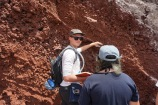 Ryan at work describing bedded cinders that compose the Red Beach cinder cone