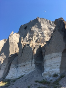 Illegal construction of a hotel in a protected area near the Akrotiri excavation site (4,000 year old Minoan city) led to a grass roots effort last May to shut it down. The window (here high in the rock face) remains.