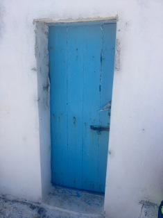 This wood door painted in Santorini blue attached to a white plastered house right on Cale Plaka Beach appeared to me representing the chance to discover a completely different view from anything I've seen before. I choose to go through the door and witness the pure beauty of Santorini and the Aegean Sea instead of staying indoors all summer on my computer.