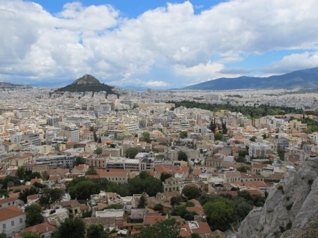 Figure 4: Overlooking Athens, Greece. With the country facing a great decline in private investment and high currency debt, Greek wages fell nearly 20% from 2010 to 2014 through deflation. As a result of falling wages, reduced income, and a rise in debt-to-GDP ratio, a severe recession fell over the country. Unemployment rose to nearly 25% from a quoted 10% in 2003 (1).