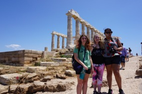 Sarah, Sarah, and Zegri at the Temple of Poseidon (Sounio) on a very windy day