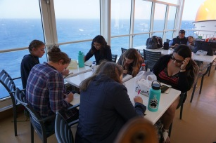 The girls taking their first test on the ferry to Santorini (2018)