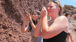 Brittany and Leah looking a minerals in scoria at Red each