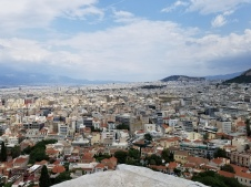 The top of the Acropolis shows the entire city of Athens. Despite the wind and dust, I appreciate the landscape below.