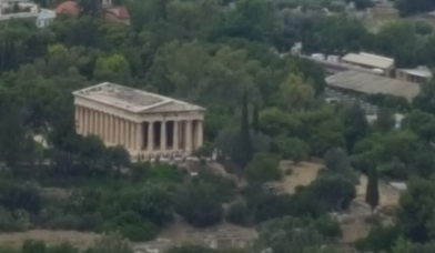 Figure 6. As people started walking up the hill to the Acropolis, many would stop by the Ancient Agora (pictured above from the top of the Acropolis). Many of the wealthy bought various meats at the market for sacrifices and the annual feast. Meats during this time were very expensive and reserved for the wealthy. The rich and powerful would have the grandest foods compared to the poor. Food, during this time, is another symbol of one's status (6).