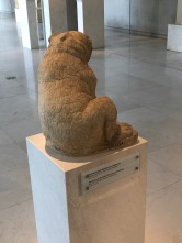 Date: June 3rd, 430 BC - I walked to Artemis Brauronia's sanctuary on the Acropolis. She is the huntress goddess. This bear, made by the sculptor Praxiteles, is on her sanctuary. The bear is sculpted with meticulous detail, especially during this time.