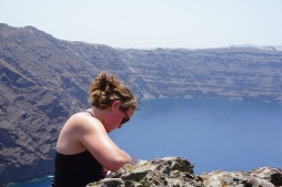 Leah looking at a basalt dike (view to the south over the caldera)