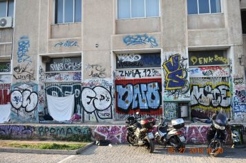 I came to learn that the city of Athens is in the middle of an economic crisis. The result: a graffiti epidemic. It's a combination of high youth unemployment and underemployment, a general unrest, and authorities being stretched too thin to do much about it. (1) As I'm not fluent in Greek, I cannot translate the Greek graffiti.