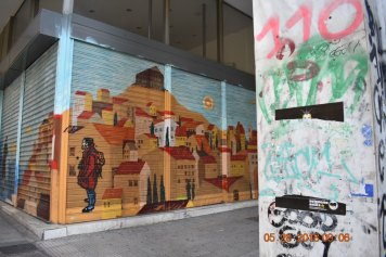 This particular image portrays the two sides of the city. The first piece of graffiti is what tourist expect to see at their arrival to Athens. In contrast, the stone structure to the right of the picture - obscured in graffiti - sheds light on the economic instability of the city. Behind the illusion of a flourishing city presented to tourists, lies the story of economic struggles that locals face with their surrounding environment.