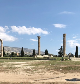 Date: June 4th, 430 BC - This morning I traveled by wooden carts to the Temple of Zeus. It took a few hours to travel to his temple, which is about 1.3 km southeast from the Acropolis. Zeus is the father of gods and humans as well as the father of the goddess Athena. The Temple of Zeus was built in 550 BC and is a sanctuary to him. Sadly, his temple was demolished in 550 BC after Peisistratus, the designer, passed away. Both of Peisistratus's sons, Hippias and Hipparchos, took over building the temple in 520 BC.(1) The temple's columns are sculpted with intricate detail. I'm looking forward to going to the Temple of Poseidon tomorrow!